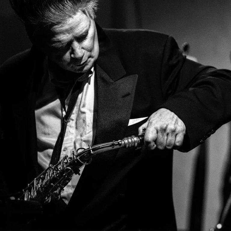 James Chance assembling saxophone